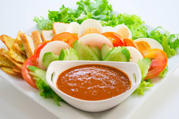 Muslim salad and salad dressing made from roasted peanuts stock photo