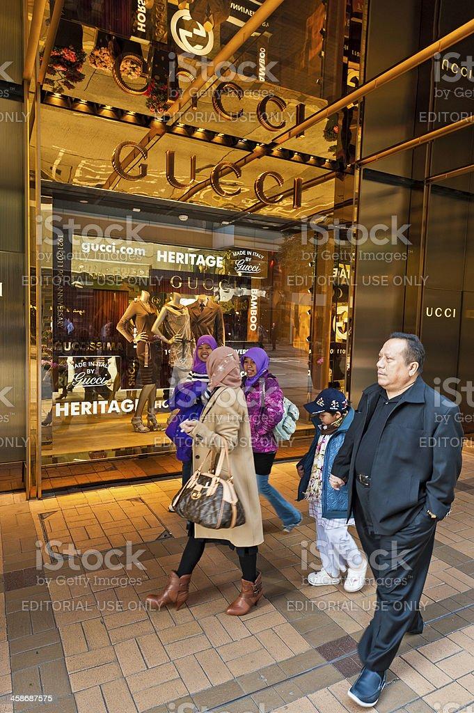 Muslim shoppers outside Gucci Hong Kong stock photo