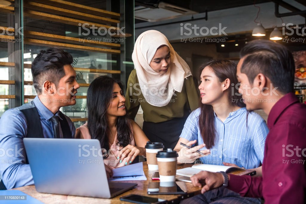 Muslim team leader encourage her team member during a business meeting