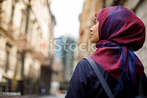 Muslim tourist exploring city