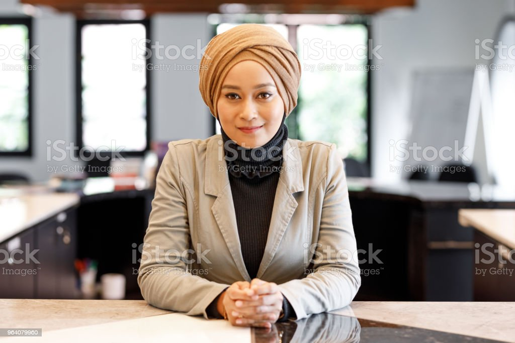 Muslim Woman At Reception Desk In Modern Office - Royalty-free Adult Stock Photo