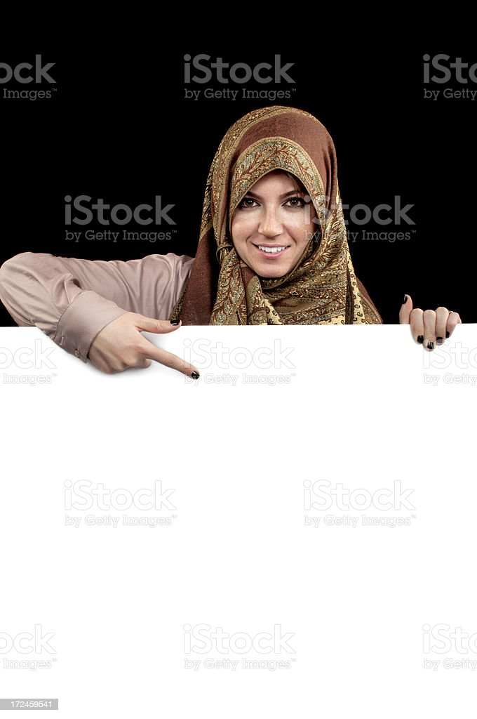 Muslim woman covering with blank billboard royalty-free stock photo
