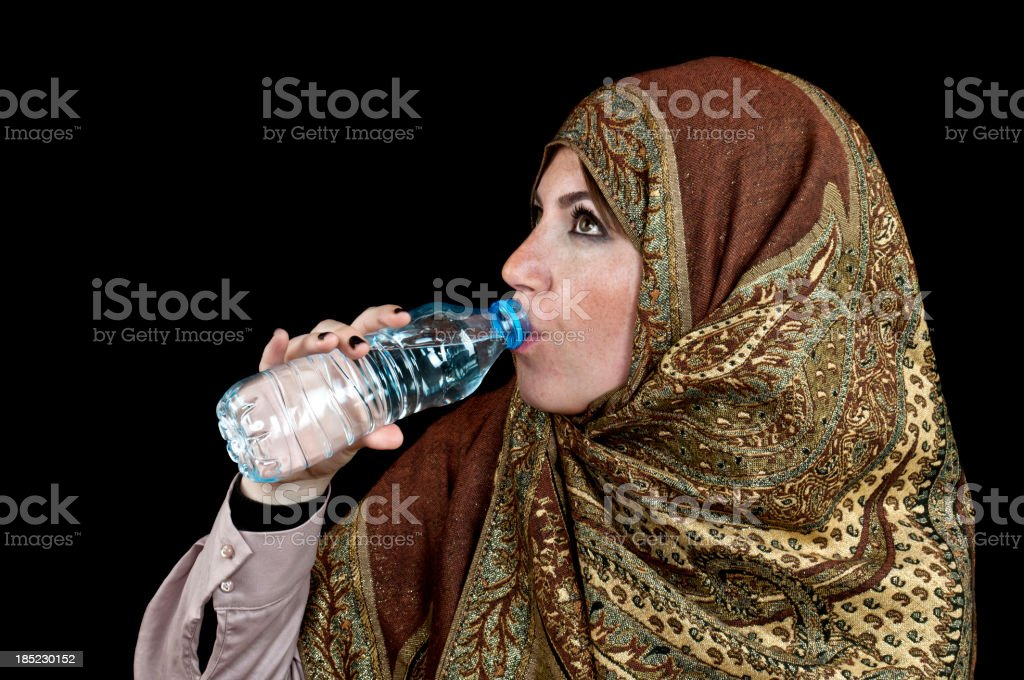 Muslim woman drinking water royalty-free stock photo