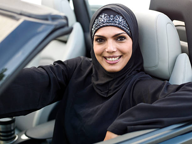 Muslim woman driving her convertible stock photo
