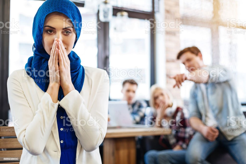 Muslim woman feeling humiliated stock photo