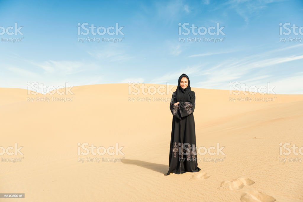 Muslim woman in desert royalty-free stock photo