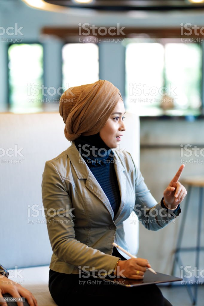 Muslim Woman in Diverse Creative Team Discussing Ideas - Royalty-free Adult Stock Photo