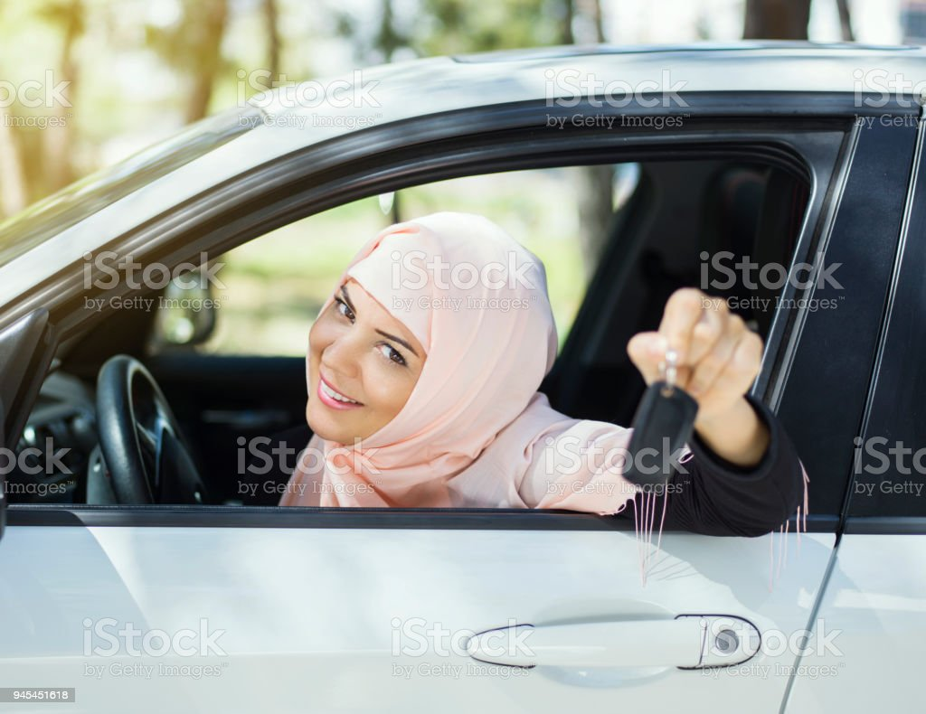 Muslim woman in her new car stock photo