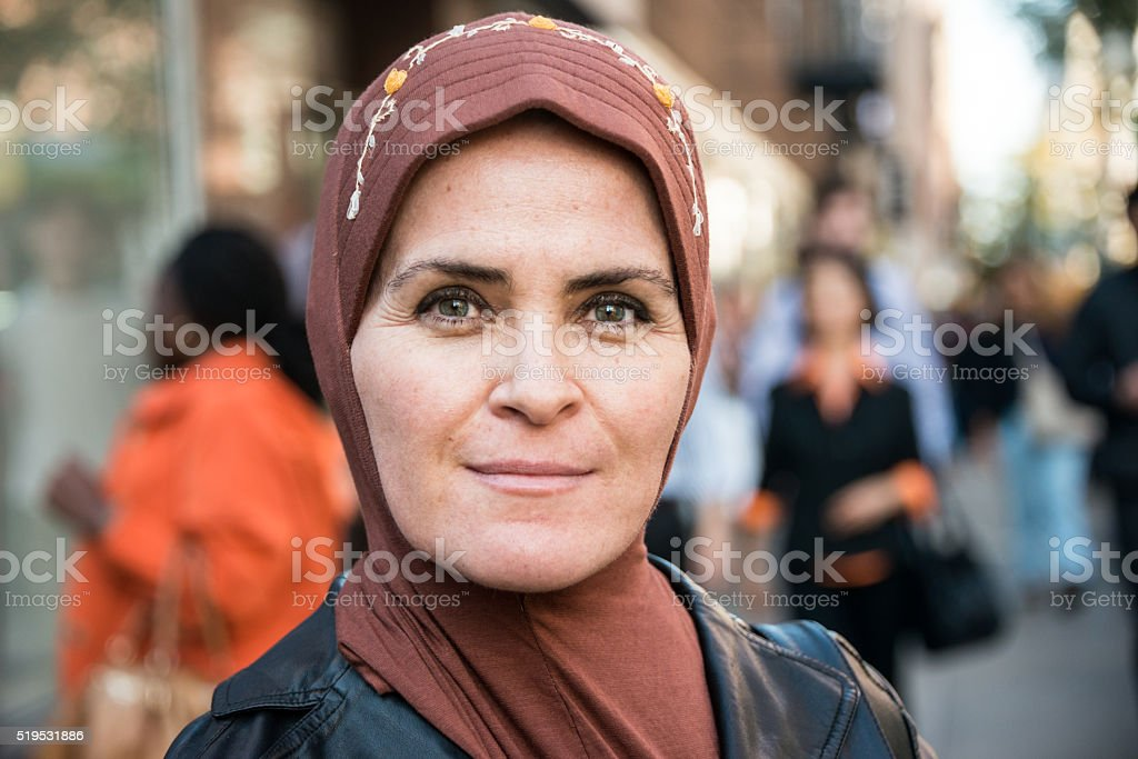 Muslim woman in the city stock photo