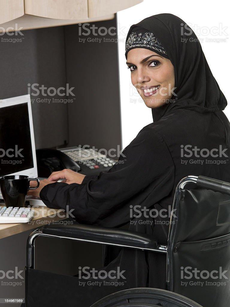 Muslim woman in wheelchair stock photo