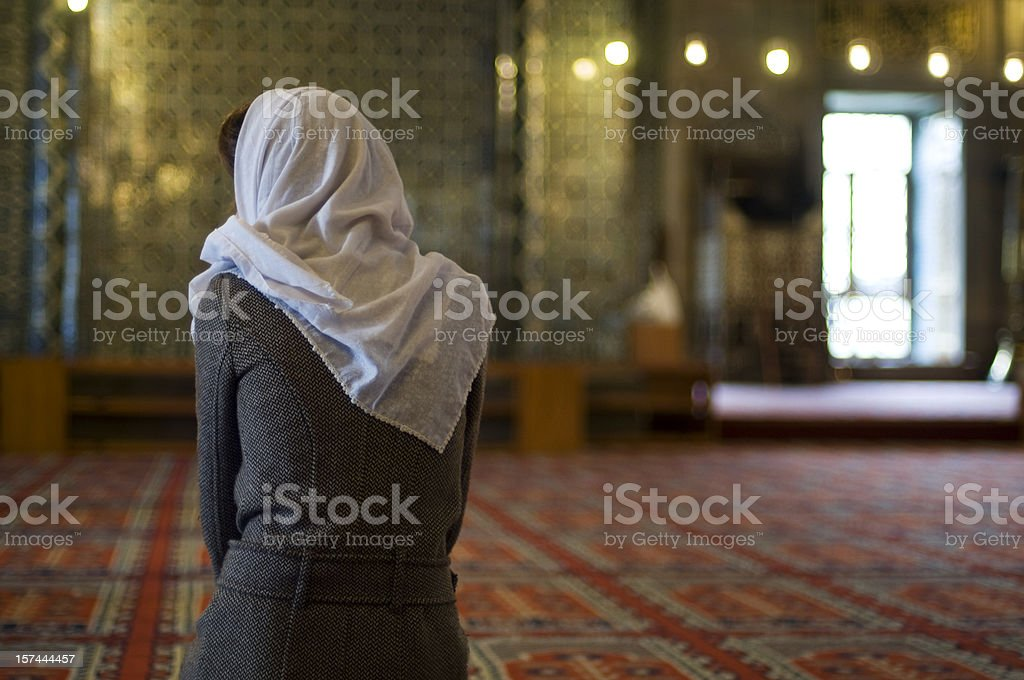 muslim woman is praying in the mosque royalty-free stock photo