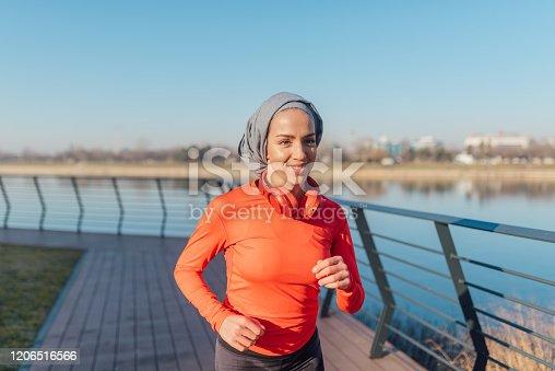 Beautiful Muslim woman doing a morning run