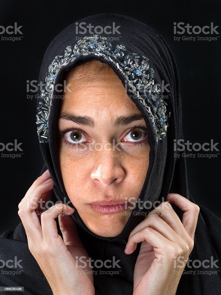 Muslim woman looking at the camera stock photo