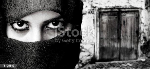 young muslim woman front of the door  (digital composite)