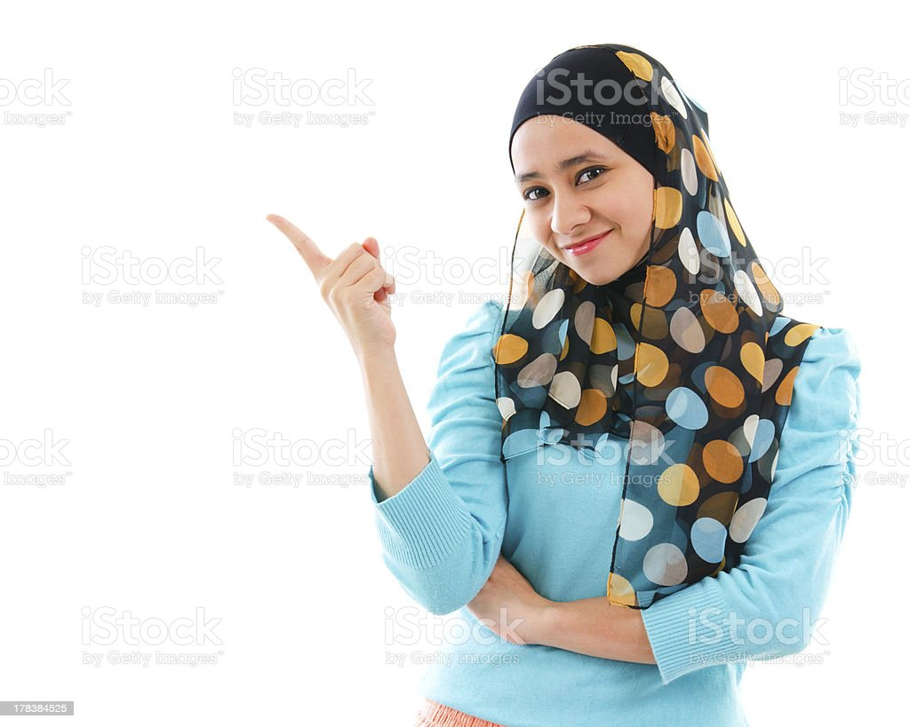 Muslim woman pointing on empty space royalty-free stock photo