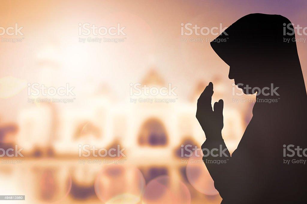 Muslim Woman pray and Beautiful background. stock photo