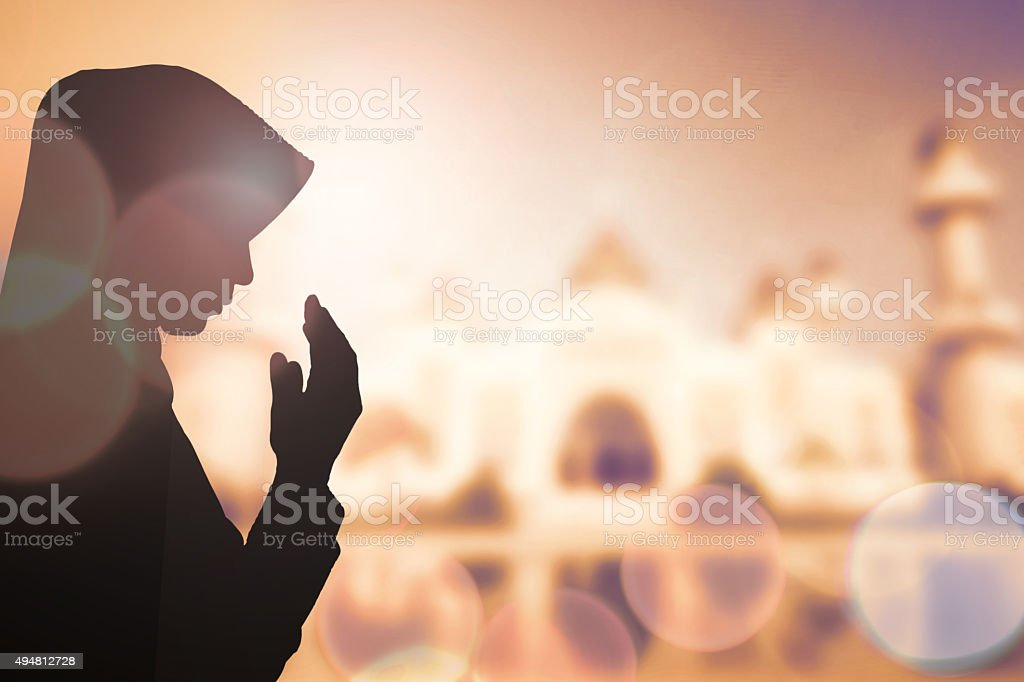 Muslim Woman pray and Beautiful background. stock photo