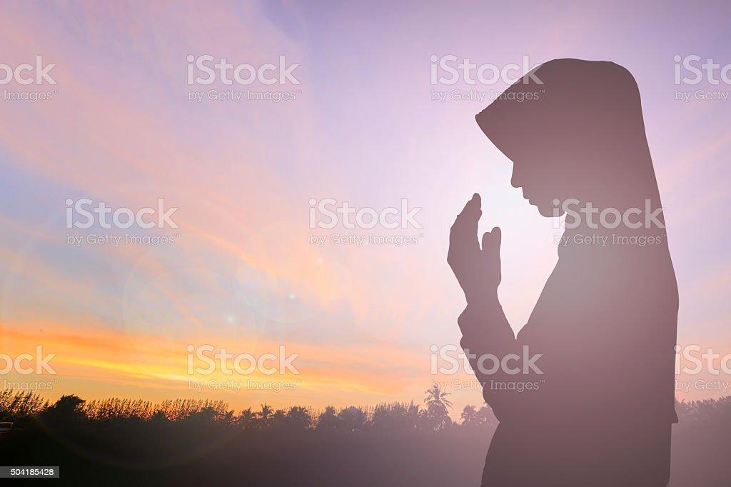 Muslim Woman pray and Beautiful background. pray for ramadan, pr stock photo