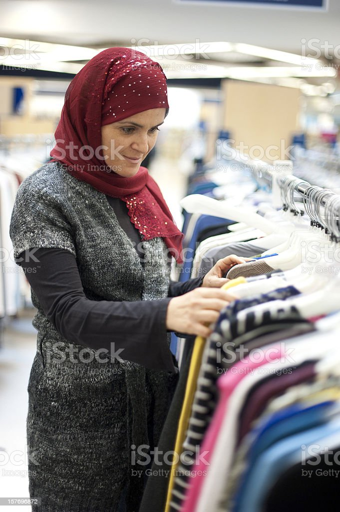 Muslim woman shopping for clothes royalty-free stock photo