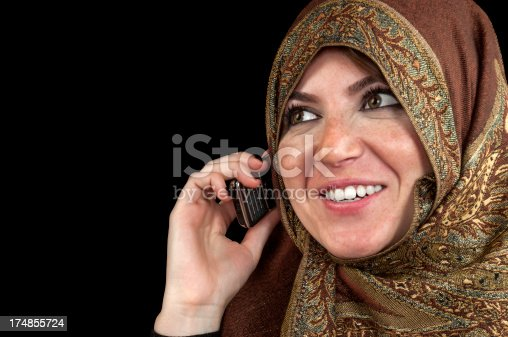 istock Muslim woman talking on mobile phone 174855724