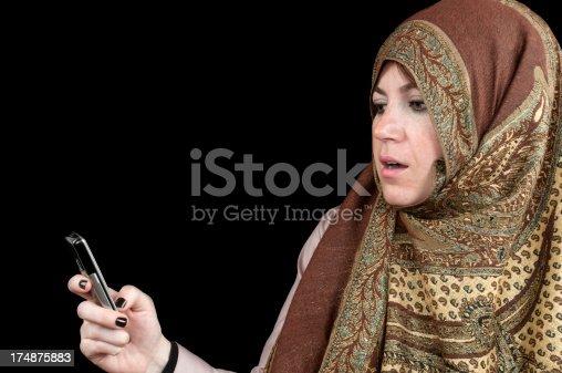istock Muslim woman using mobile phone 174875883