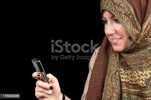 istock Muslim woman using mobile phone 175000335