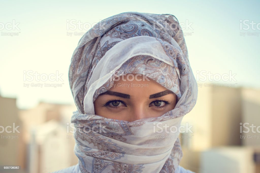 Muslim woman wearing traditional Arabic clothing outdoors. stock photo