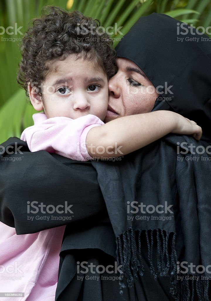 Muslim woman with her son royalty-free stock photo