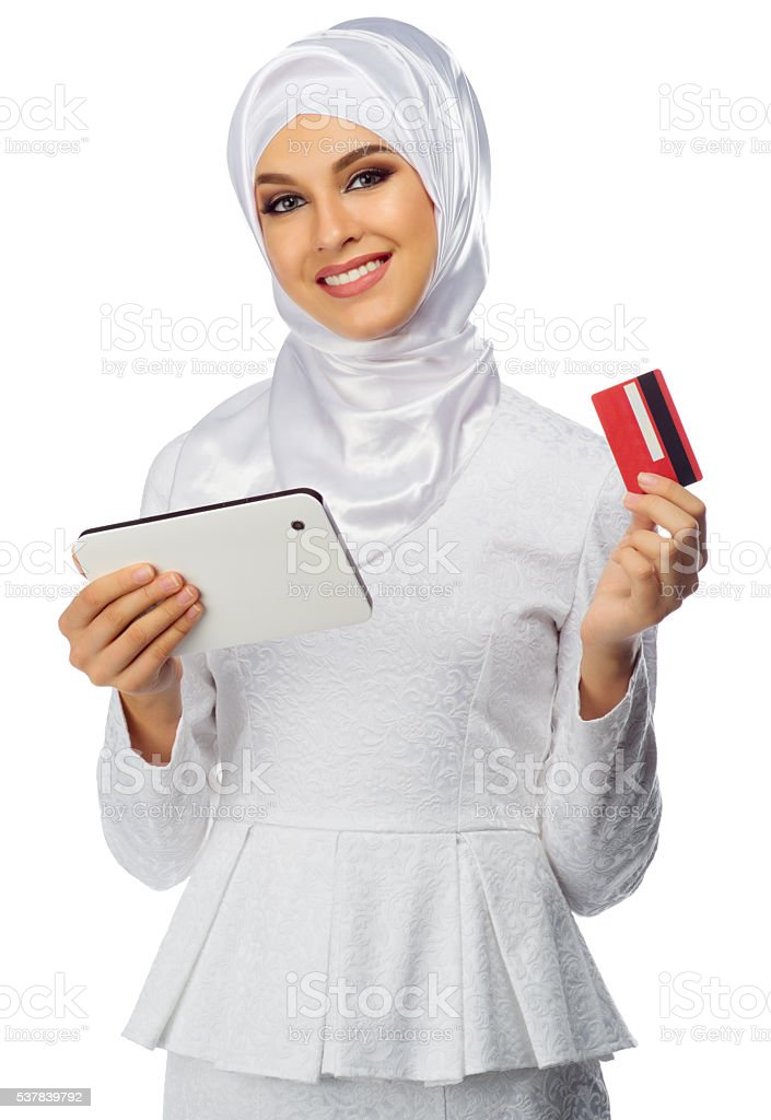 Muslim woman with tablet PC and credit card stock photo