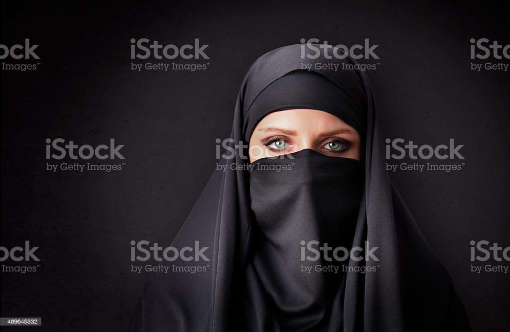 Muslim woman with traditional black veil stock photo