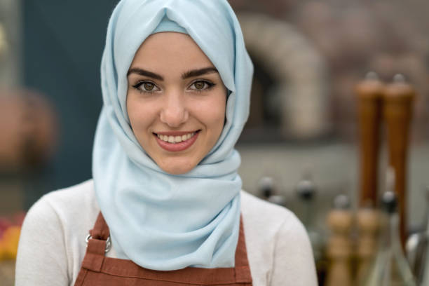 Muslim woman working at a restaurant stock photo