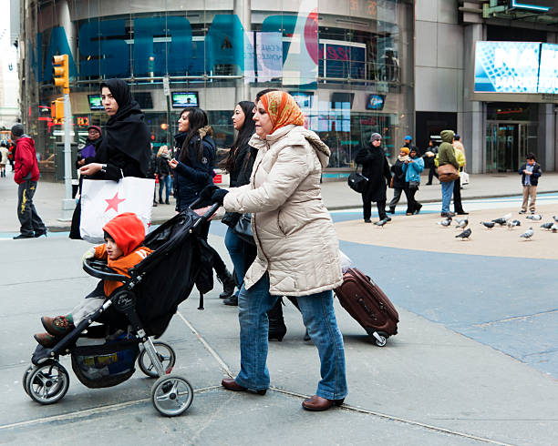Muslim women after shopping on Broadway stock photo