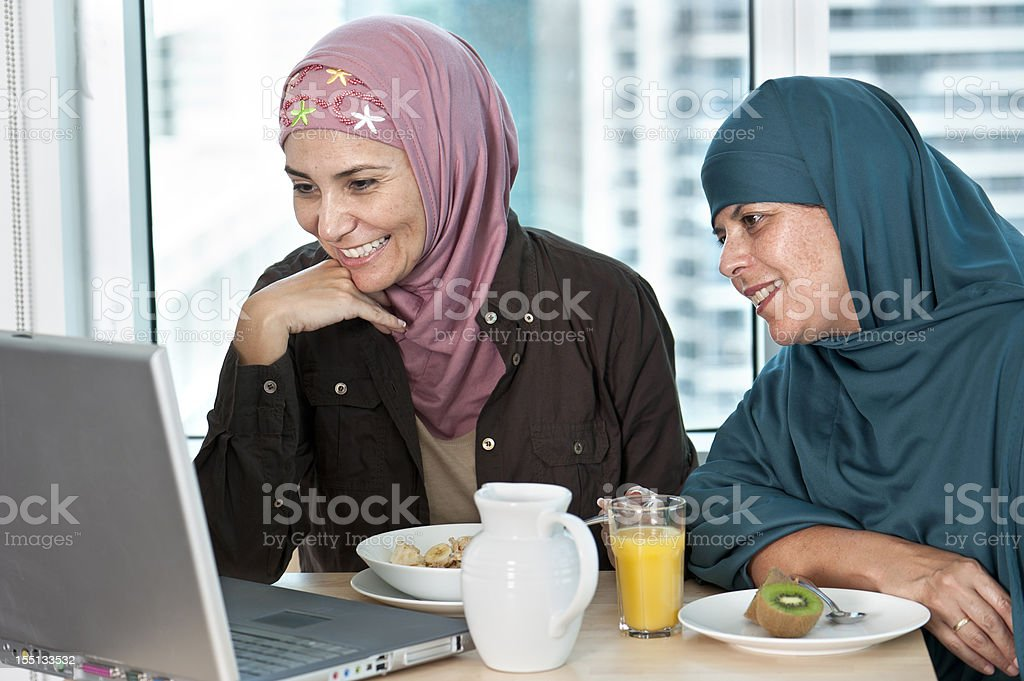 Muslim women having breakfast royalty-free stock photo