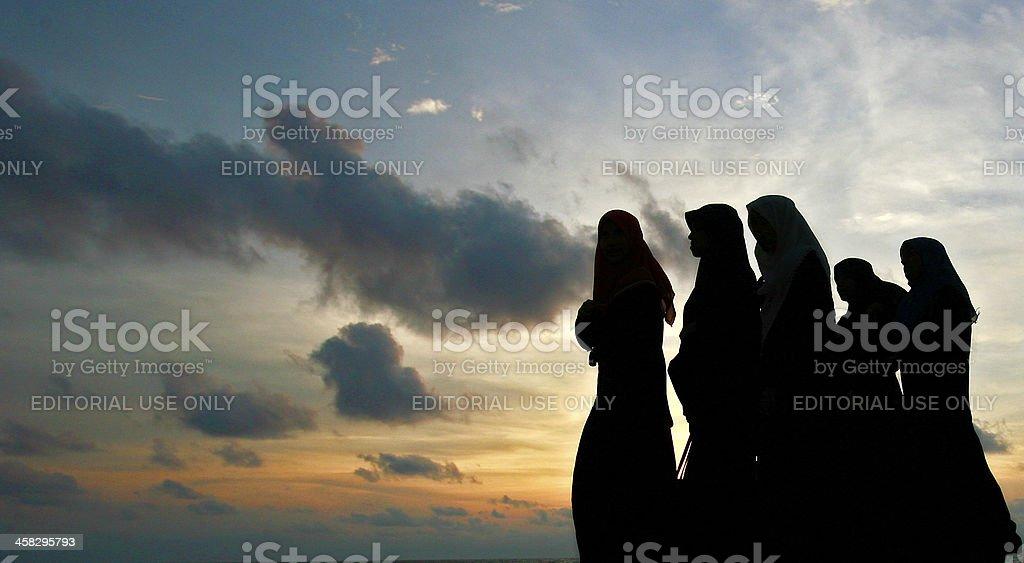 Muslim women in evening stock photo