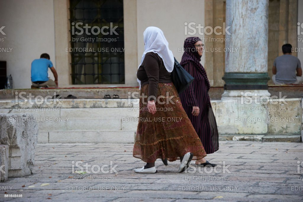 Muslim women in the main Sarajevo Mosque of Gazi Husrev-beg. stock photo