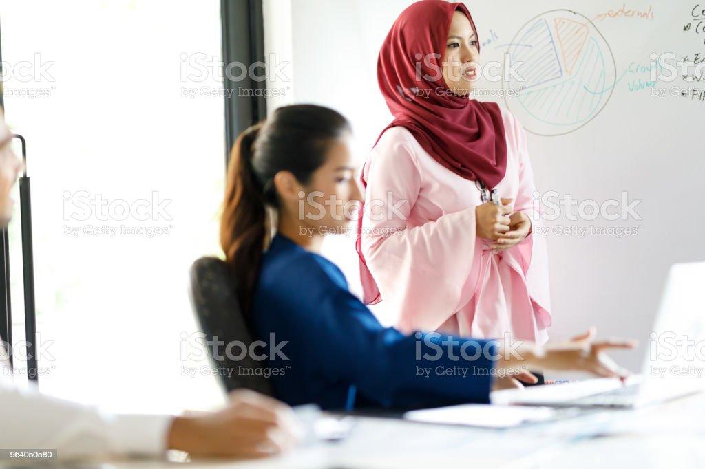 Muslim Women Leading Diverse Sales Team - Royalty-free Adult Stock Photo