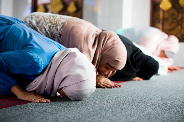 Muslim women praying in the mosque during Ramadan Muslim women praying in the mosque during Ramadan islam stock pictures, royalty-free photos & images