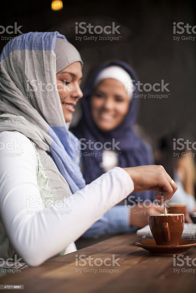 Muslim women stirring her tea. stock photo