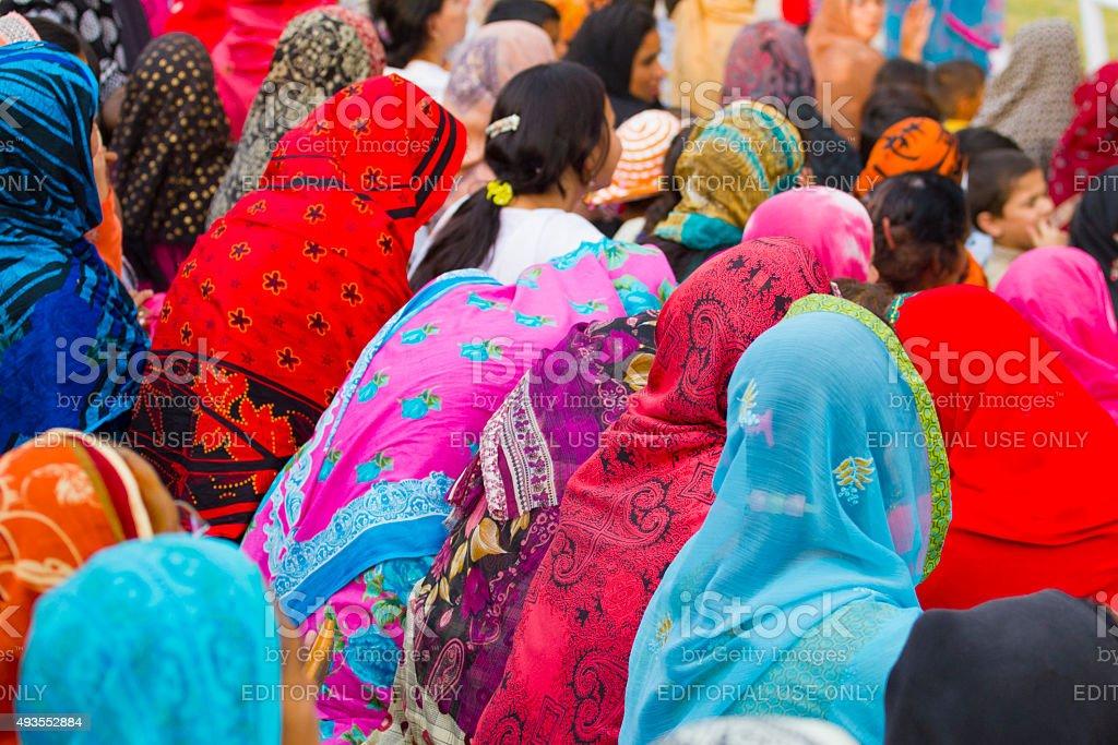 Muslim women wearing colorful headscarves stock photo