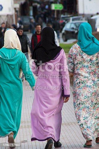 Rabat, Morocco - November 09, 2016: Three Muslim women wearing colourful clothes walking in Rabat