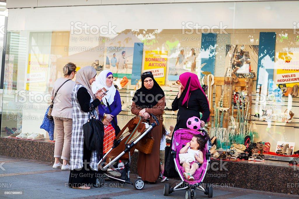Muslim women with baby buggies and children royaltyfri bildbanksbilder