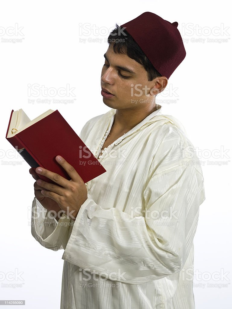 Muslim Young Man reading a book royalty-free stock photo