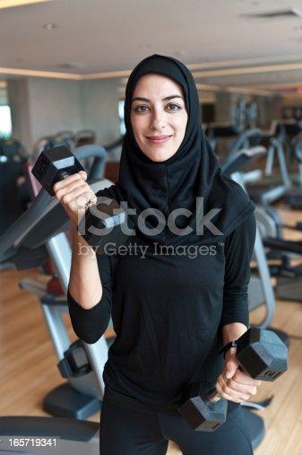 istock Muslim Young Woman Exercising 165719341