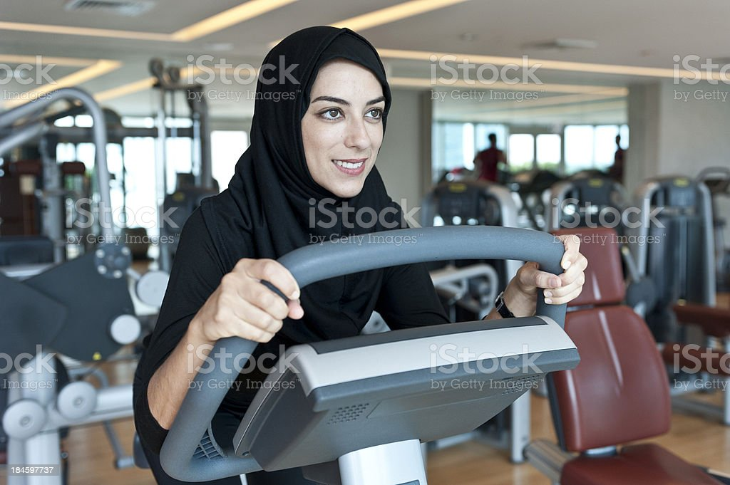 Muslim Young Woman Exercising stock photo