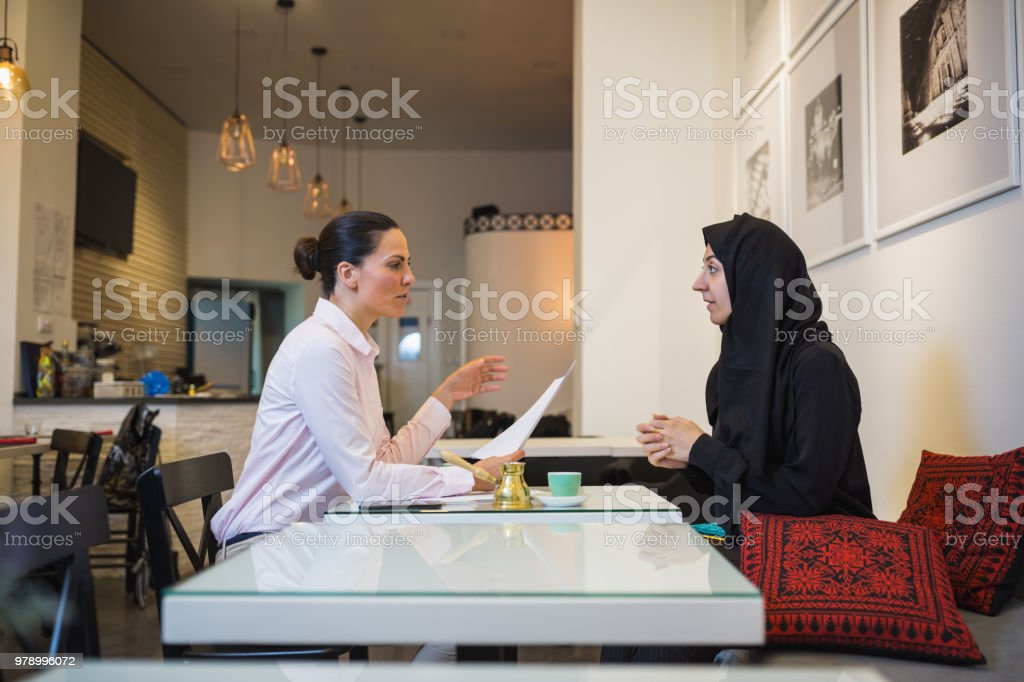 Muslim Young Woman On Business Meeting At Cafe Stock Photo Download Image Now Istock