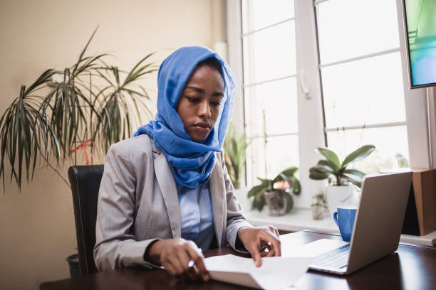 Muslim young woman working in office stock photo