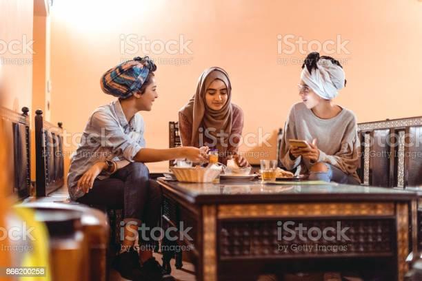 Muslim young women having a lunch break together in an arab picture id866200258?b=1&k=6&m=866200258&s=612x612&h=4zkddtxbkxiwrb 2hl8mcckmi2bw6fuihzvi50qjrtm=