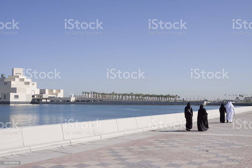 Muslims along Doha Corniche stock photo