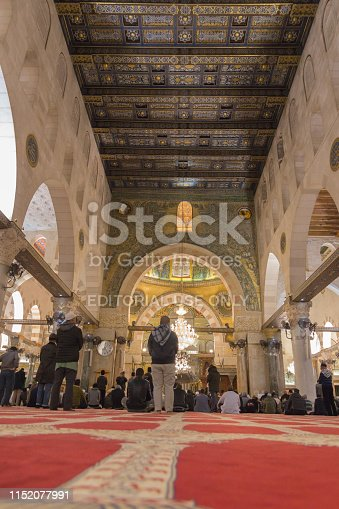 Muslims are praying at the inside of Al-Aqsa Mosque at Aqsa Complex in the Old City of Jerusalem.