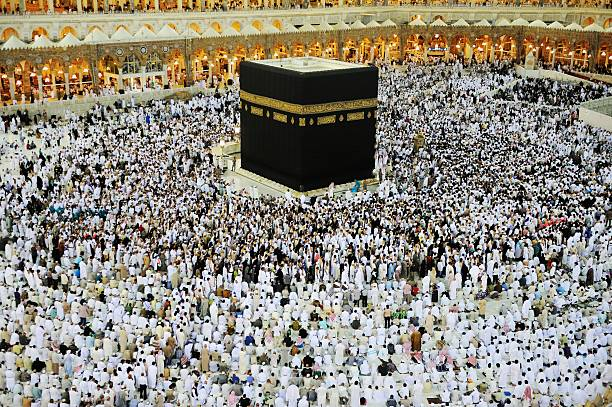 Muslims from all around the world coming for Hajj Mecca, Saudi Arabia - May 24, 2012: Muslims from all around the world coming for Hajj in Kaaba circumambulation stock pictures, royalty-free photos & images
